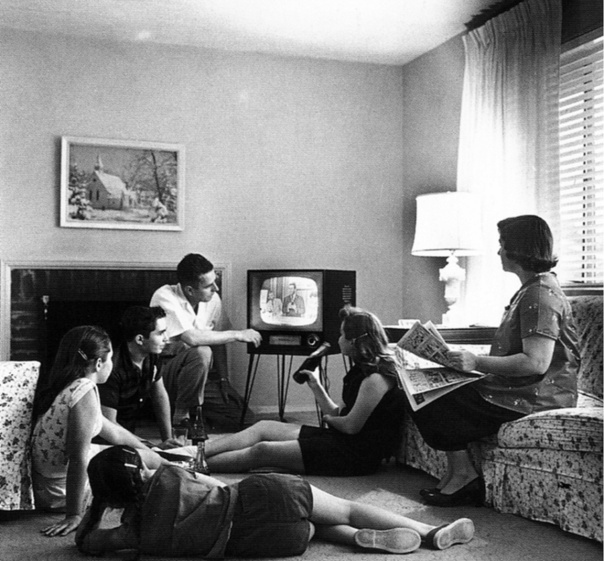 http://upload.wikimedia.org/wikipedia/commons/9/97/Family_watching_television_1958.jpg